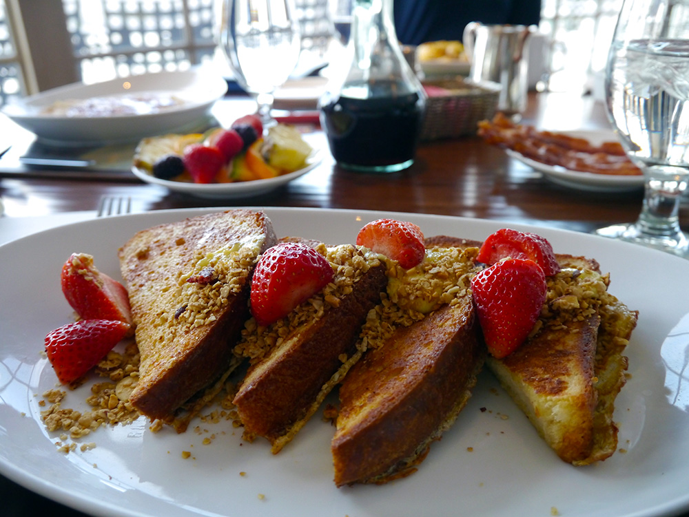 Freshly baked Brioche French Toast topped with strawberries, hazelnut granola and orange curd. Credit: Nicola Brown