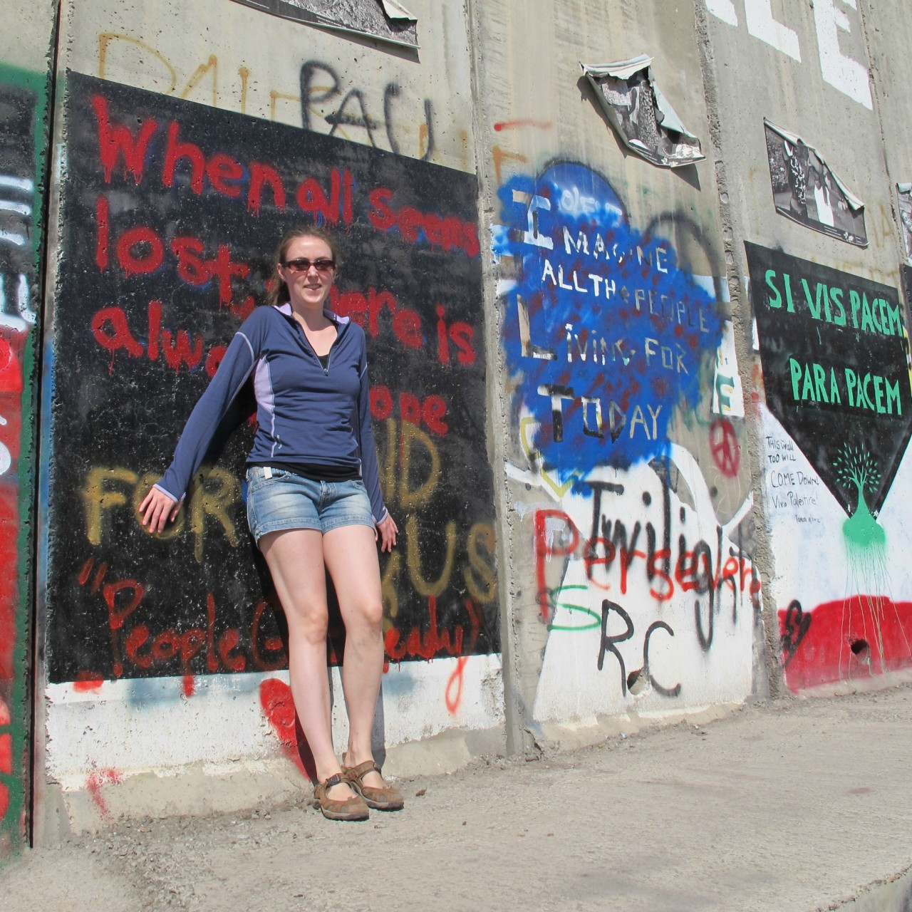The author visiting the Separation Barrier in Palestine