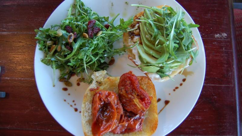 Avocado Sandwich on Grilled Ciabatta with Roasted Tomato, Pomegranate, Vegenaise, and Arugula